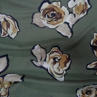 Jersey lycra vert asperge motif fleurs decoupees 3