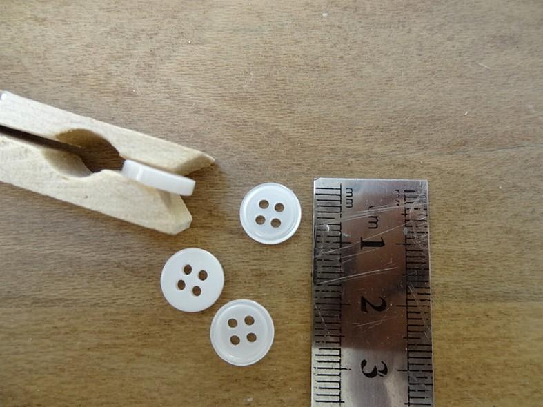 Bouton blanc casse nacre bord bourrelet 10 mm