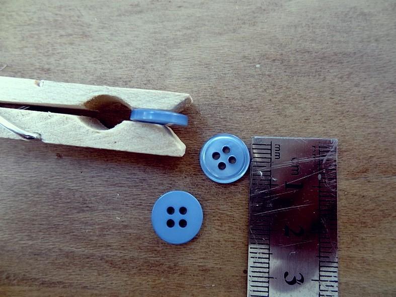 Bouton bleu acier nacre bord bourrelet 11 mm