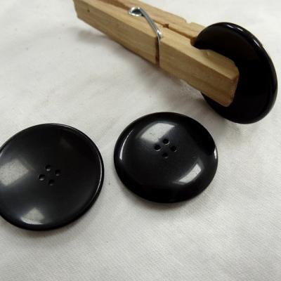 Bouton incurve noir 27 mm 1
