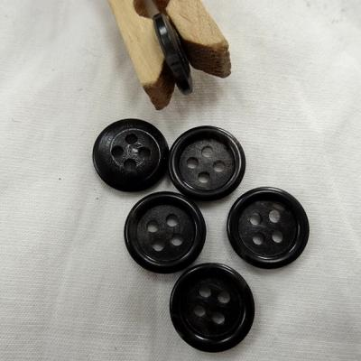 Bouton noir bordure bourrelet 15 mm 1