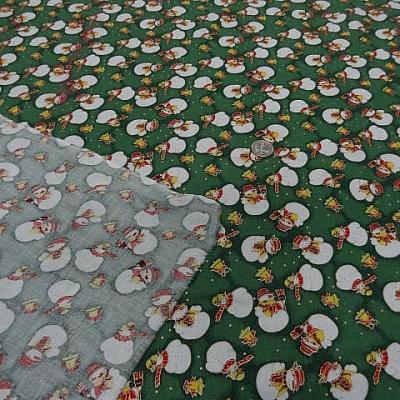 Coton fond vert motif