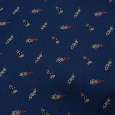 Coton imprimé bleu petits chiens habillés