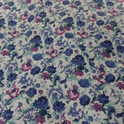 Coton popeline blanche imprimee petite fleurs bleu