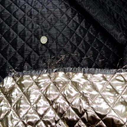 Coupon de doublure matelasse double face dore noir 2 5m0