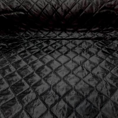 Doublure matelassee polyester noire couture carreaux