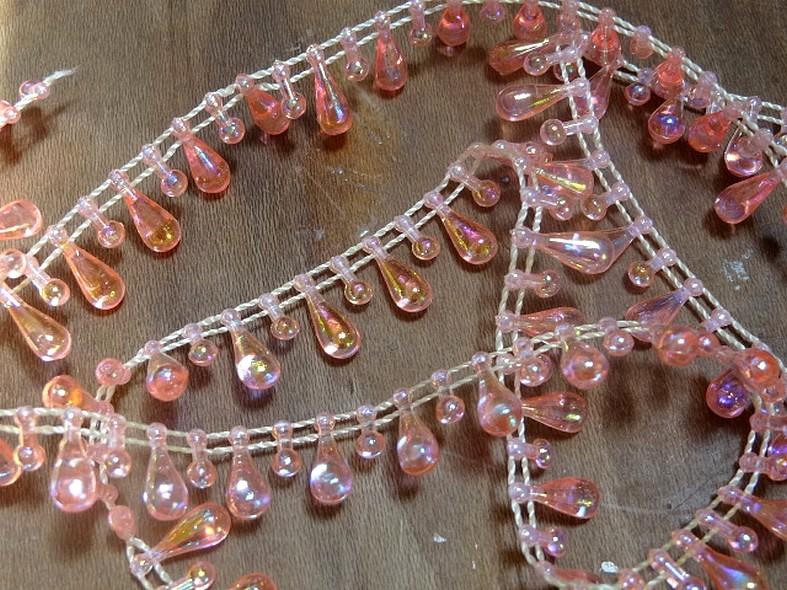Fil de perles en goutte rose transparent 1