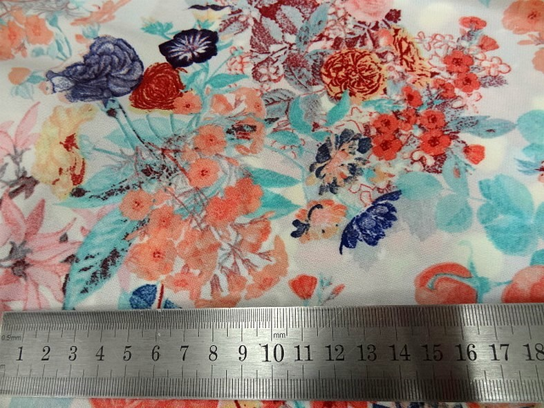 Lycra fin blanc fleuri teintes saumon bleu 2