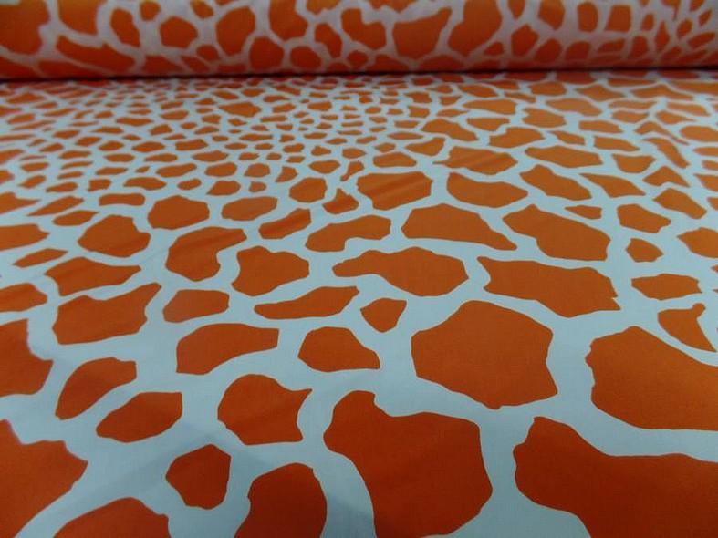 Lycra imprime taches de girafe fond blanc motif orange et jus d orange 1