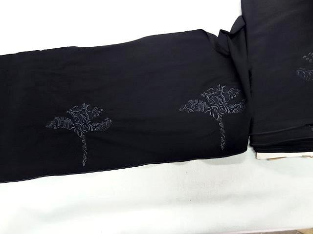 Motif fleur stylisee brodee noire sur lycra