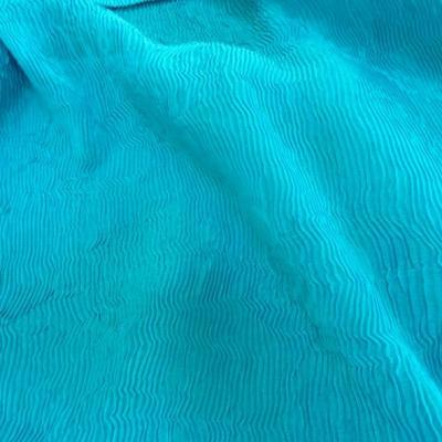 Mousseline polyester plissee magma bleu des mers du sud 4