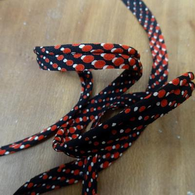 Passepoil en coton noir a pois rouge 1