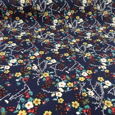 Popeline coton bleu marine fleurs et tiges rouge et jaune 1