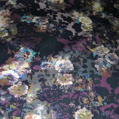 Popeline coton lycra noir prune motif oeillets 1