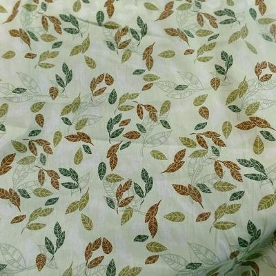 Popeline coton vert clair tilleul motif feuillage 2