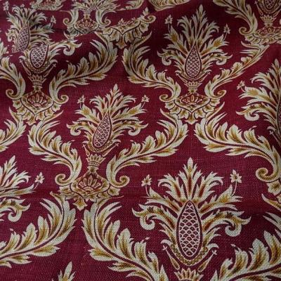 Toile de jute imprimée motif baroque fond rouge framboise